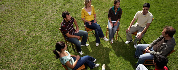 Group therapy session being held outdoors